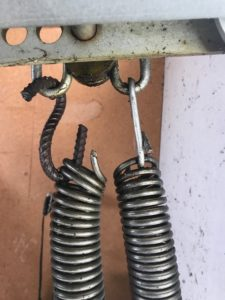 Wire tilt door spring fix - A very dangerous Horror story photo.